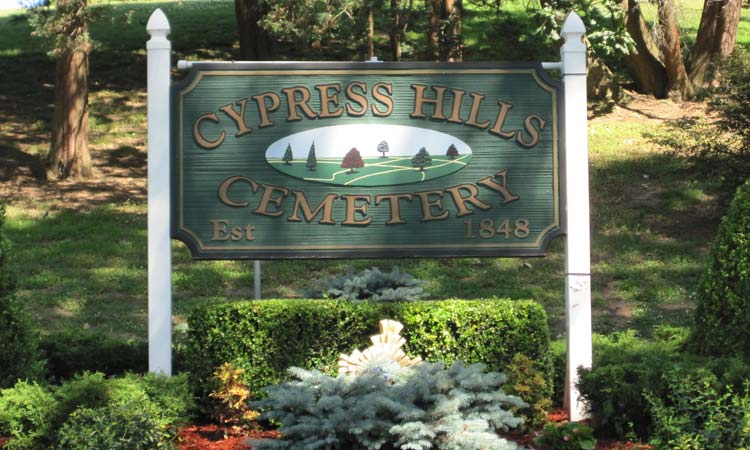 Cypress-Hills-Cemetery-Wooden-Sign-at-Entranceway