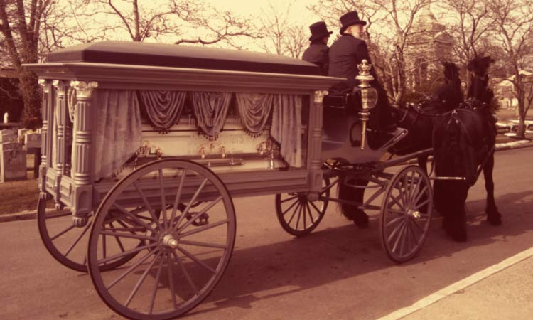 Old-fashion-funeral-horse-drawn-carriage